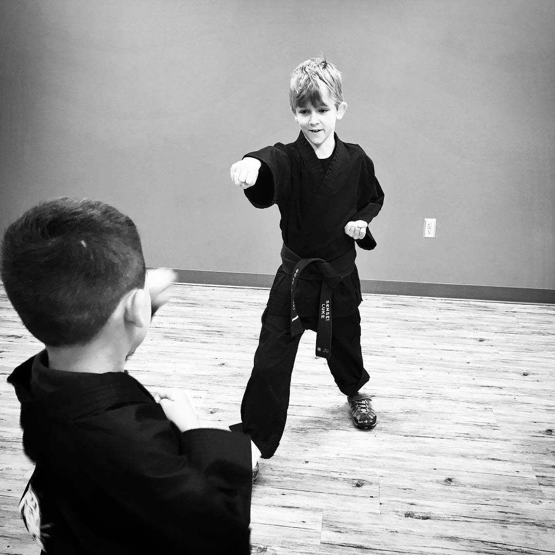 My #junior #blackbelt son helping teach a young #whitebelt – a #happy moment for this #prouddad  #karate #bushido #martialarts #dojo #goju #shorei #family #training #strength #character #student #mindfulness #naperville #illinois